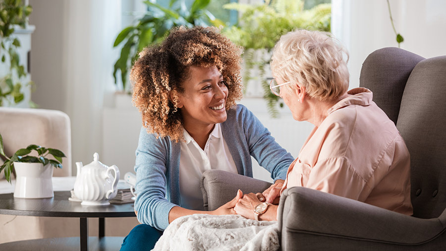 Long-term care provider spending time with an elderly person